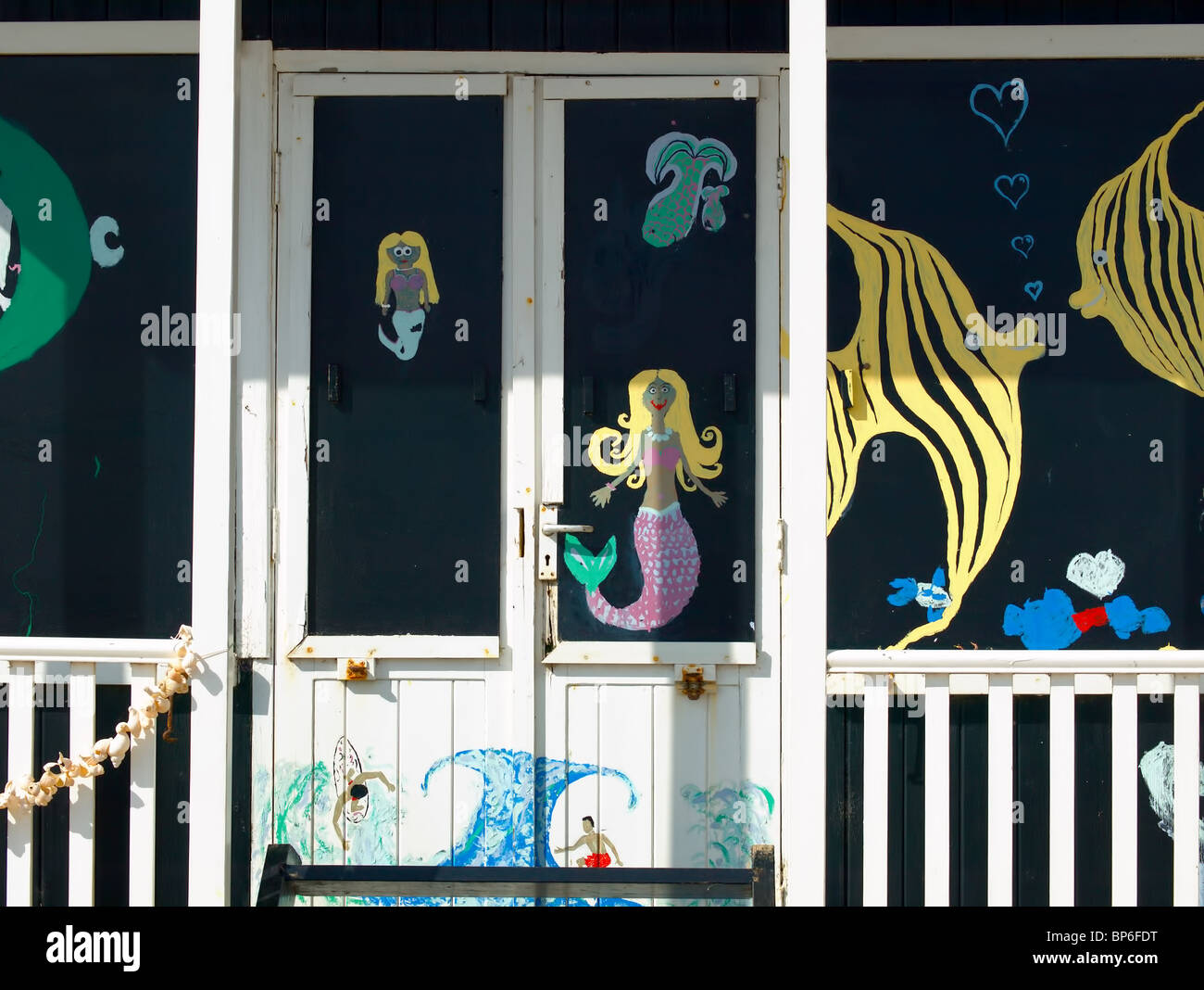 A painted beach hut on the promenade at Sutton-on-sea,Lincolnshire,UK. - Stock Image