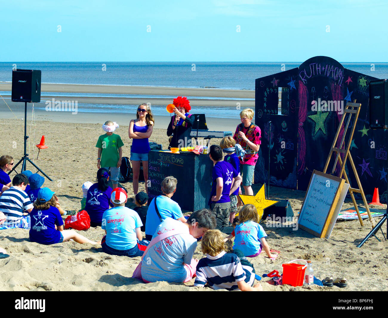 Beach entertainers,entertaining families on the beach at Sutton-on-sea,Lincolnshire,UK. - Stock Image