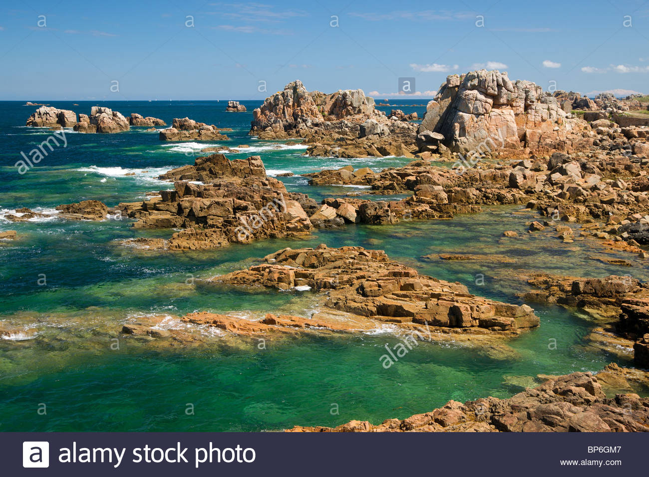 Pink granite rocks and clear water at Plougrescant (near Perros Guirec) - Brittany - France - Stock Image