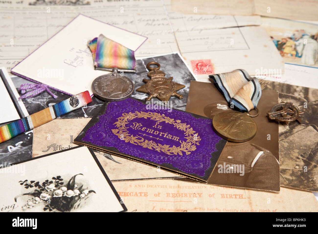 A collection of family documents and photographs being used to research the family tree. Includes articles from - Stock Image