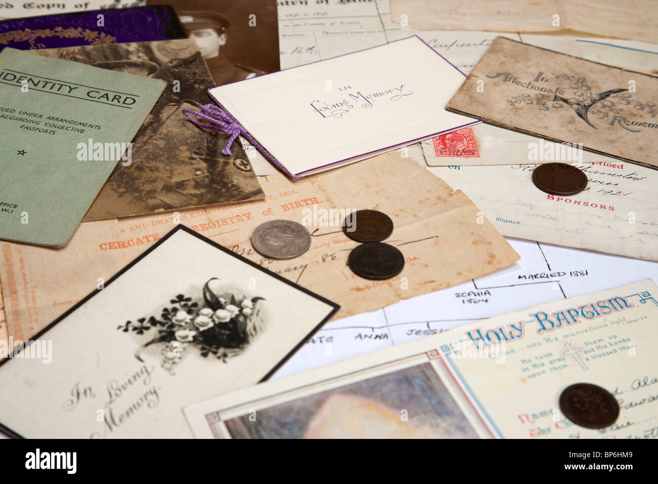 A collection of family documents and photographs being used to research the family tree - Stock Image
