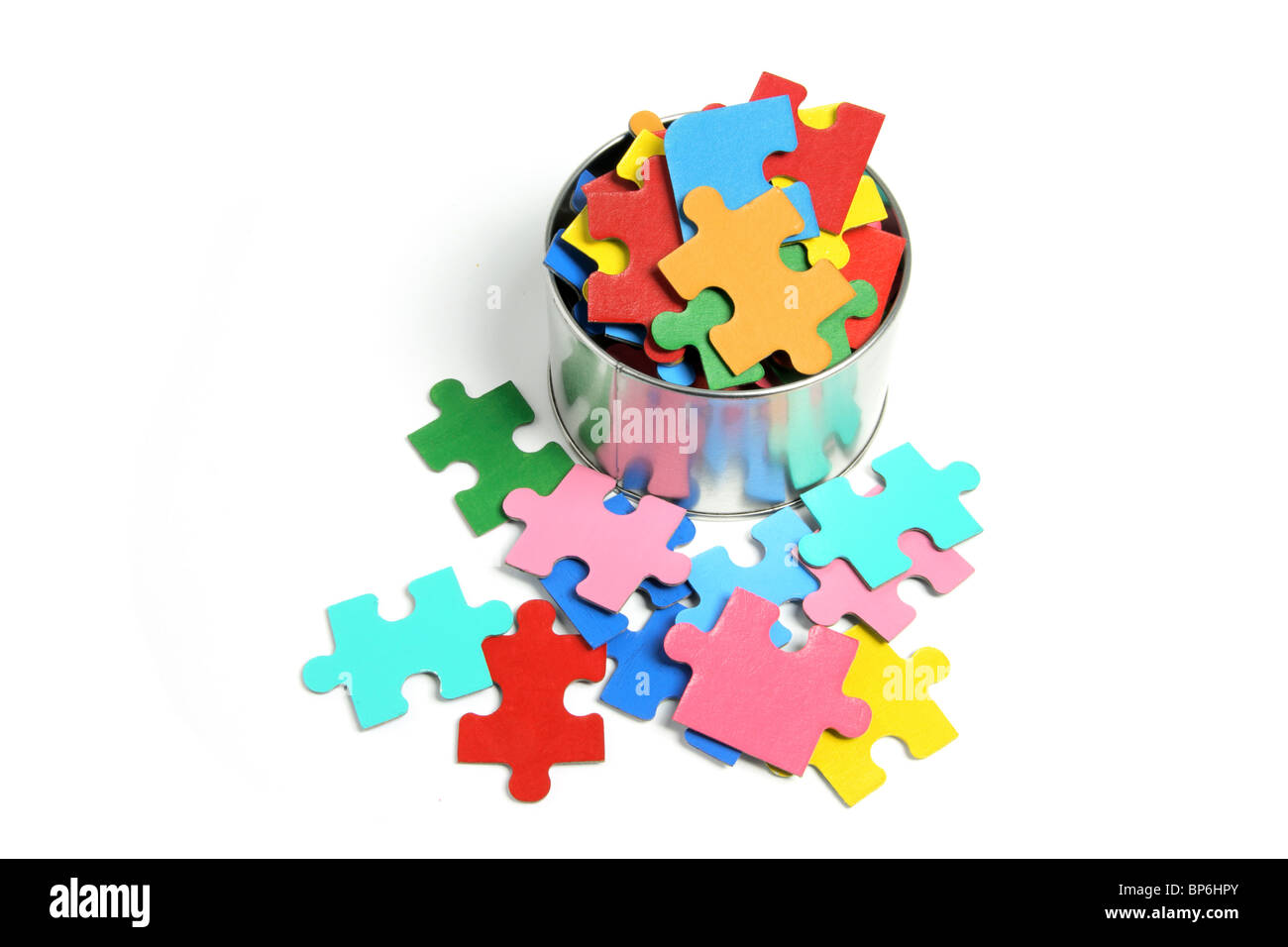 Jigsaw Puzzle Pieces in Tin Can - Stock Image