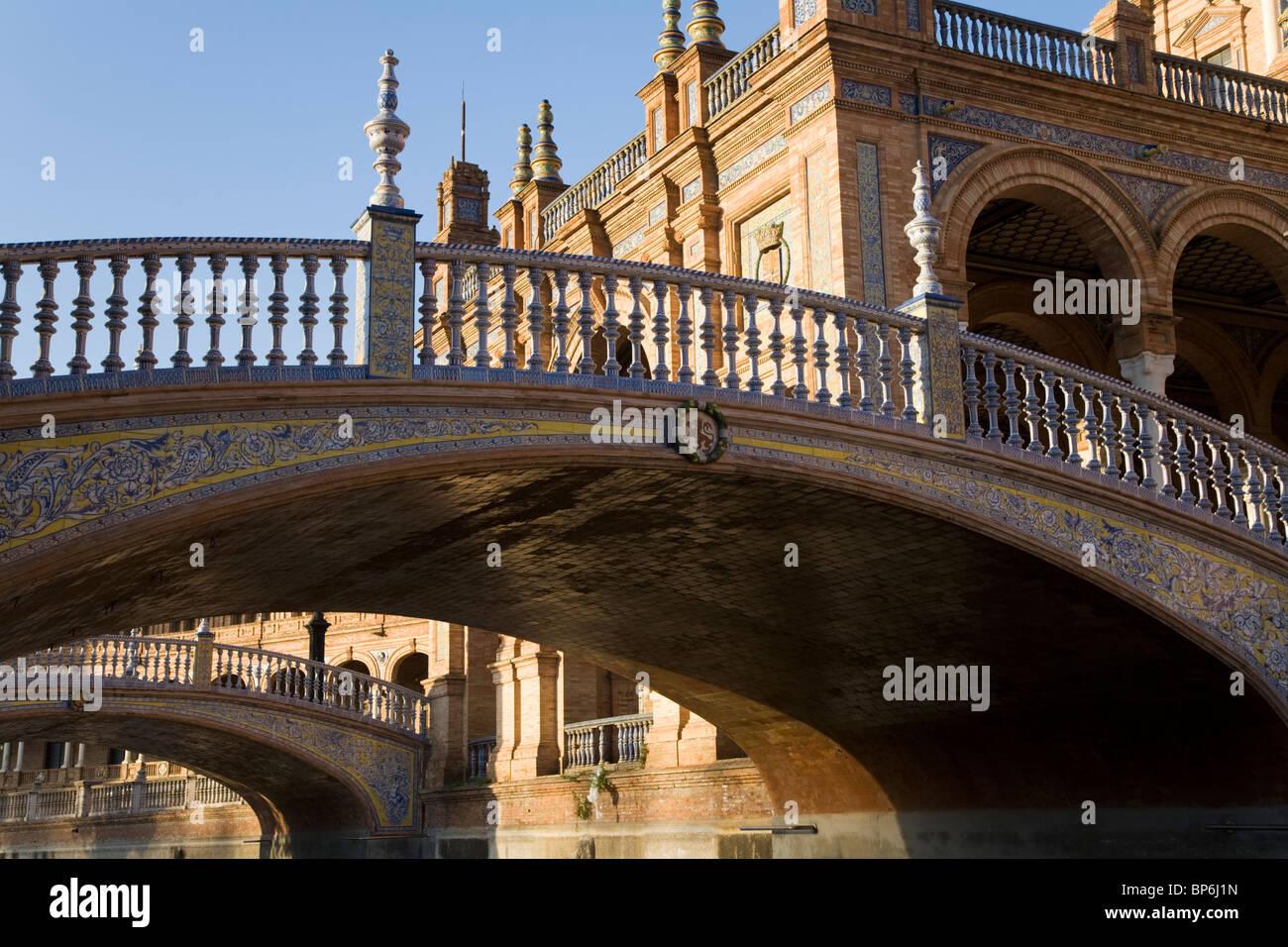 A bridge crossing / crosses over the moat of Seville's Plaza de España de Sevilla. Seville, Spain. On a - Stock Image