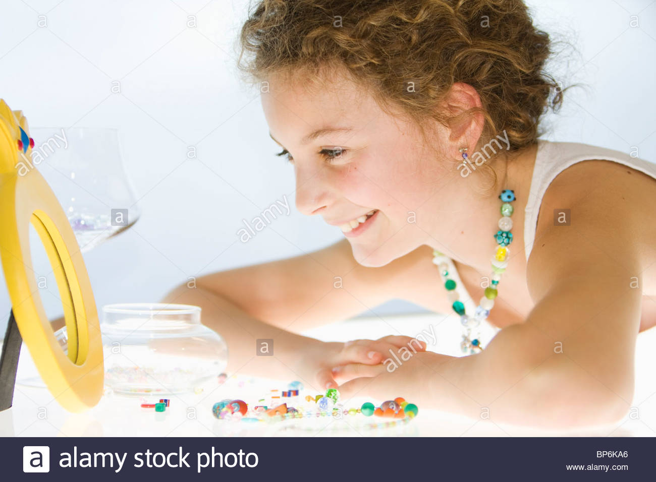 A young girl wearing a bead necklace - Stock Image
