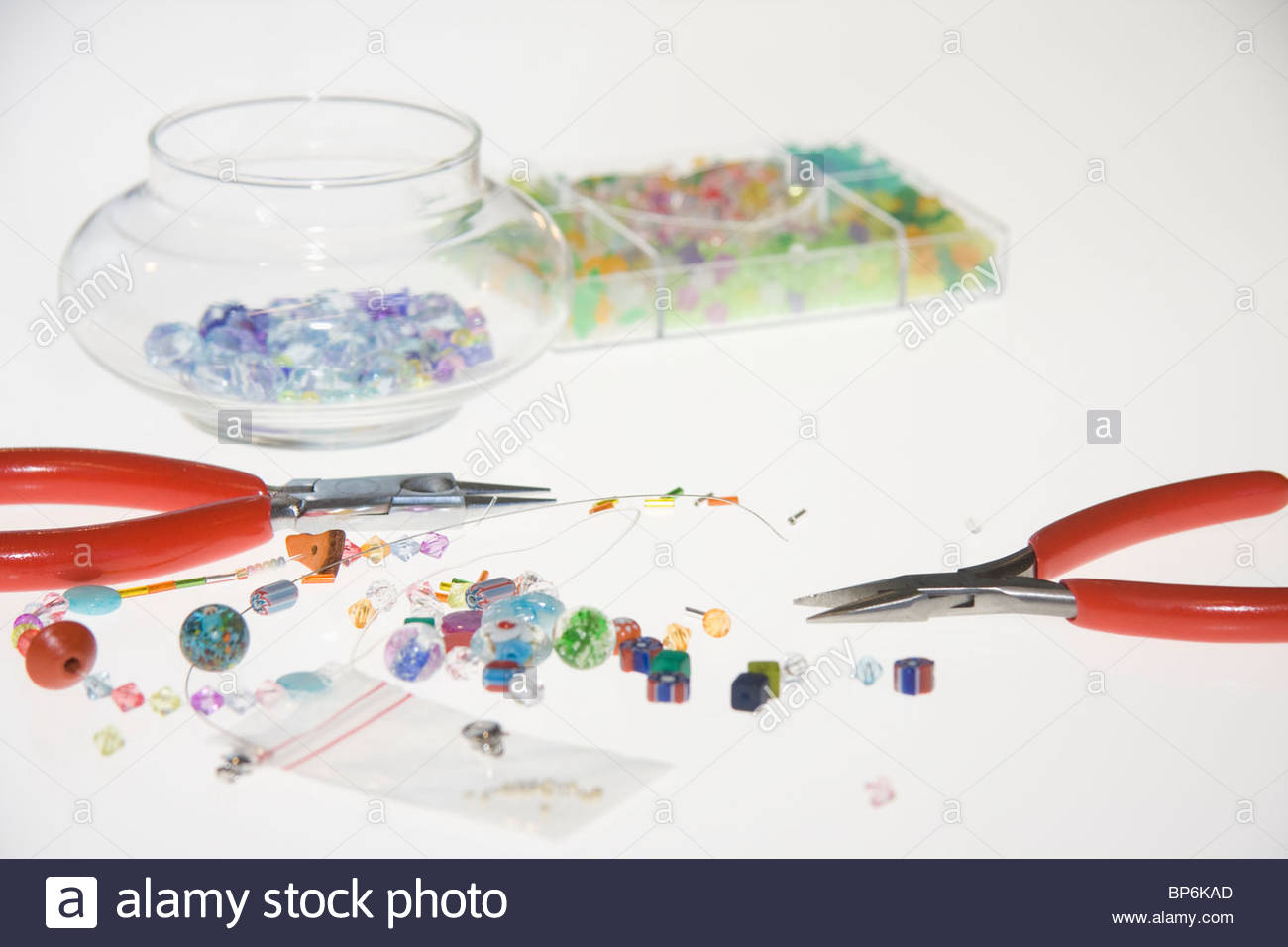 Colored beads and tools for making jewelry - Stock Image
