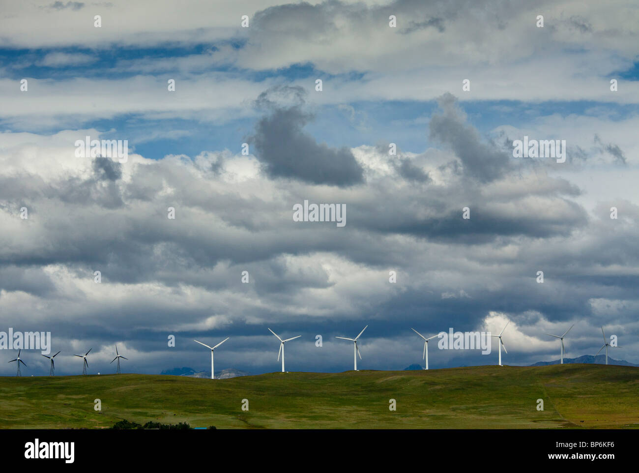 Windmills at Pincher Creek, Alberta, with the Rockies beyond, in stormy weather; Canada - Stock Image