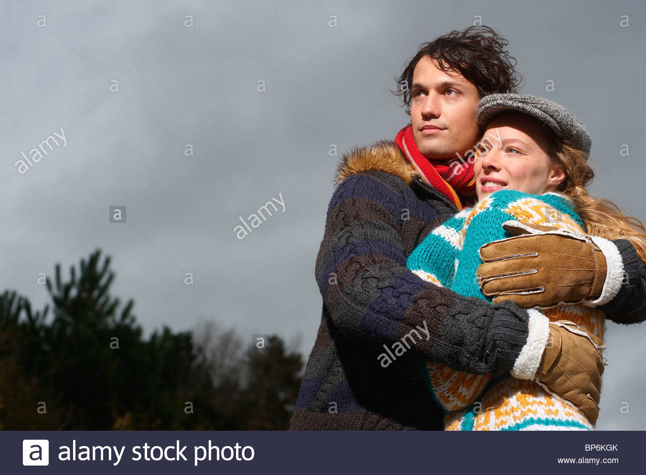 A couple embracing on a cold winters day - Stock Image