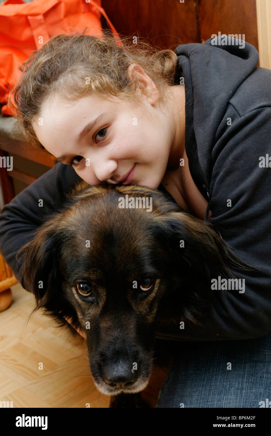 portrait of a young girl and her pet dog - Stock Image
