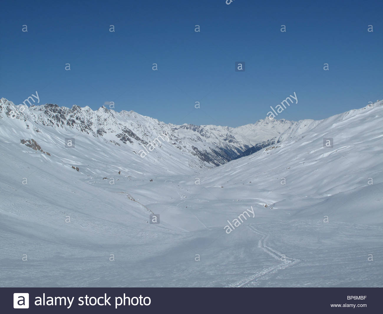 Snow-capped mountains in Fimbatal, the border between Switzerland and Austria, Ischgl - Stock Image