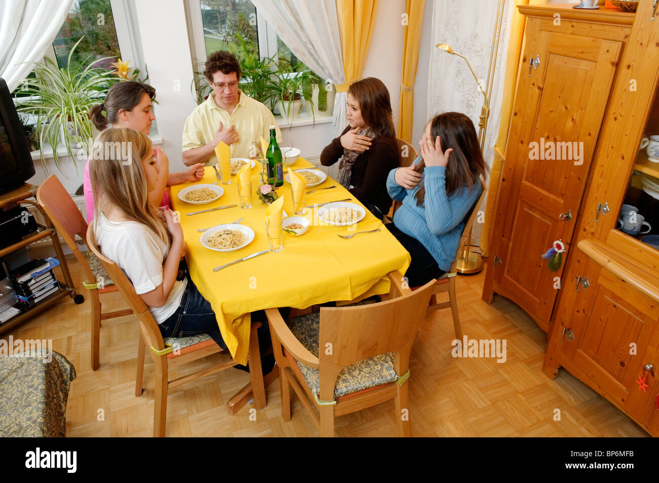 family saying grace before the meal Stock Photo