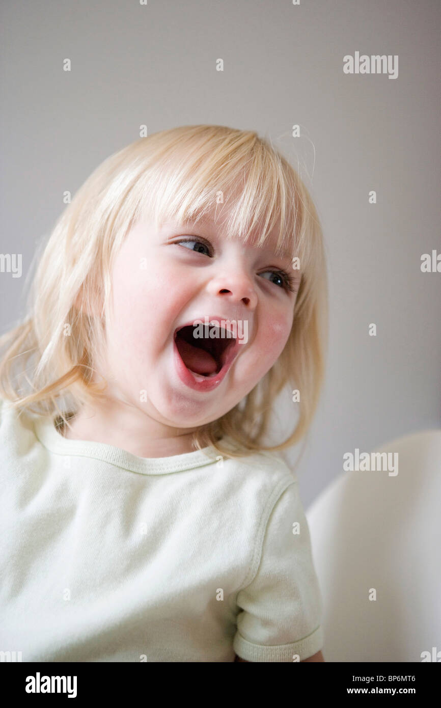 A young girl laughing - Stock Image