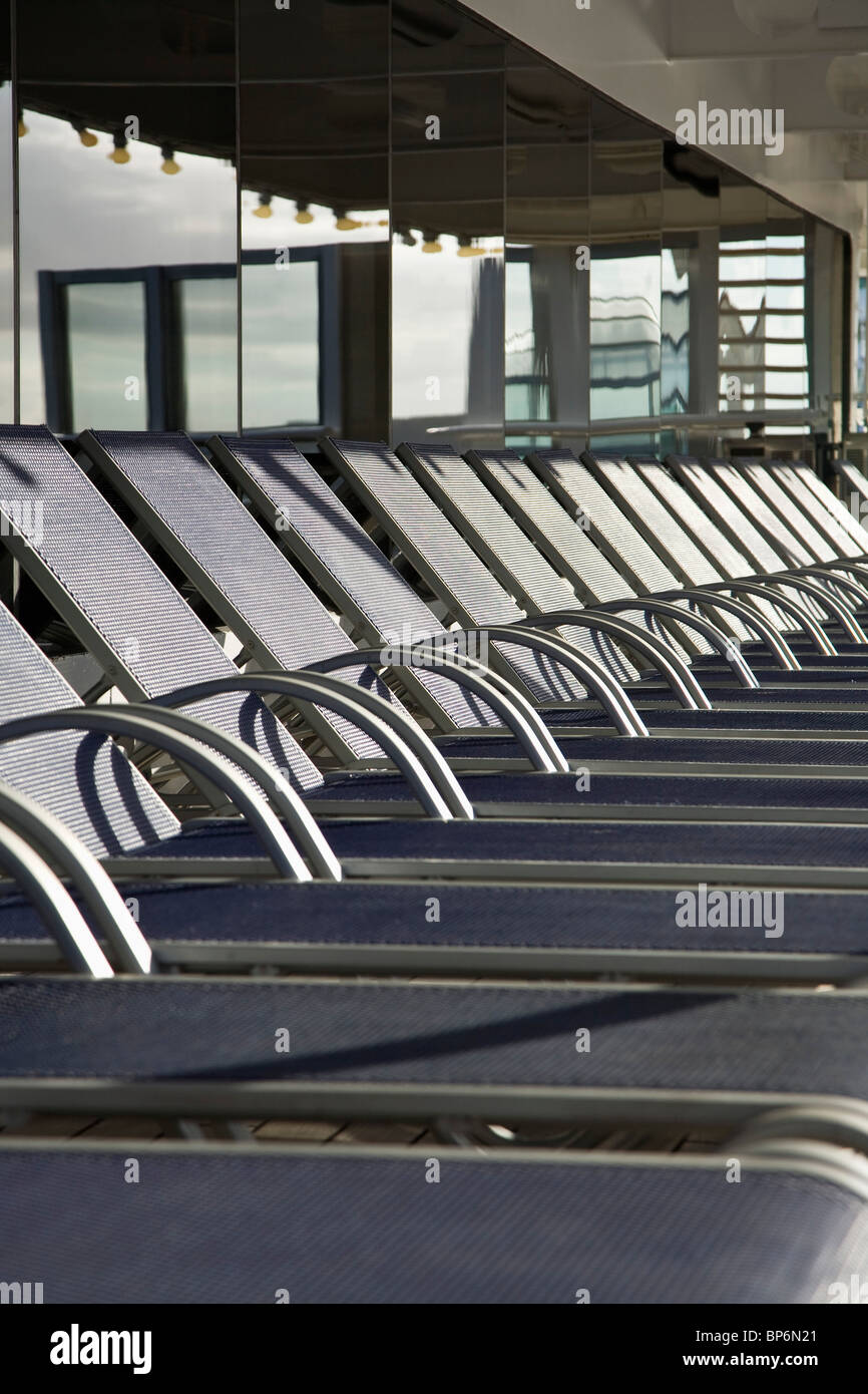 Detail of sun lounges on a cruise ship - Stock Image