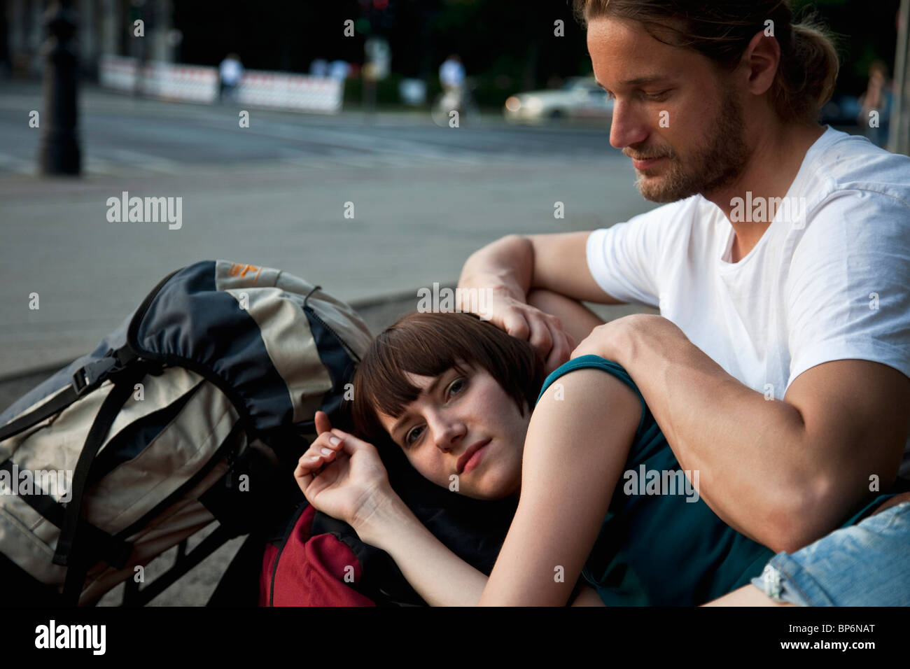 A young backpacker couple resting - Stock Image