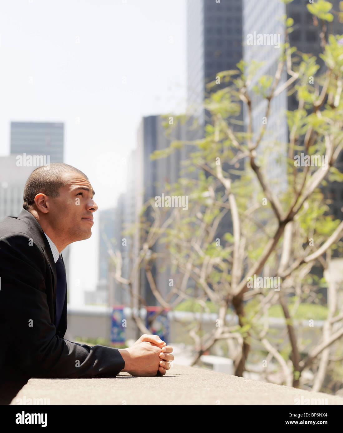 Portrait of a contemplative businessman - Stock Image