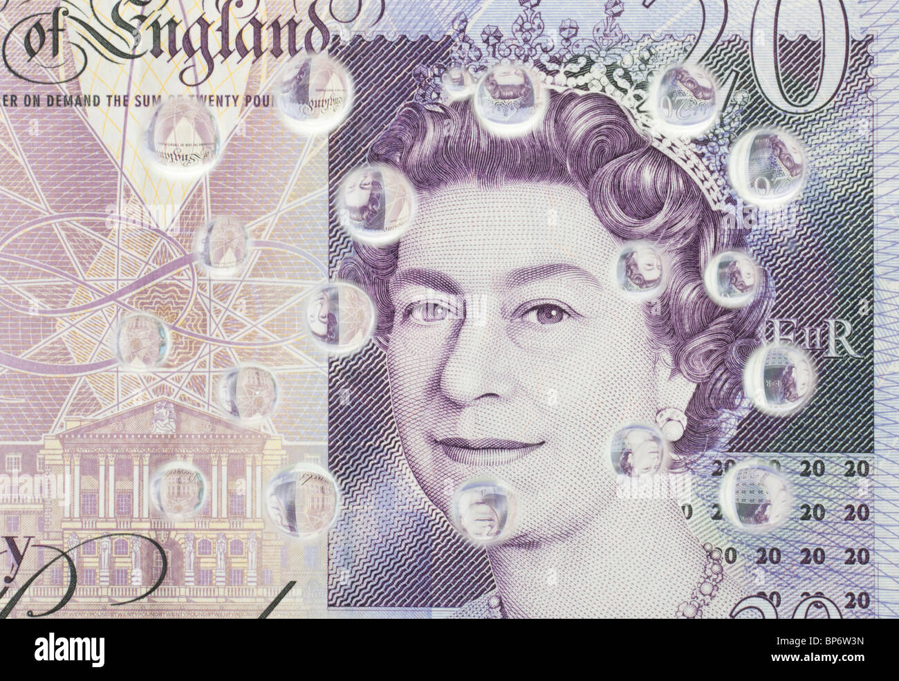 Water droplets reflecting on a twenty pound note in British currency - Stock Image