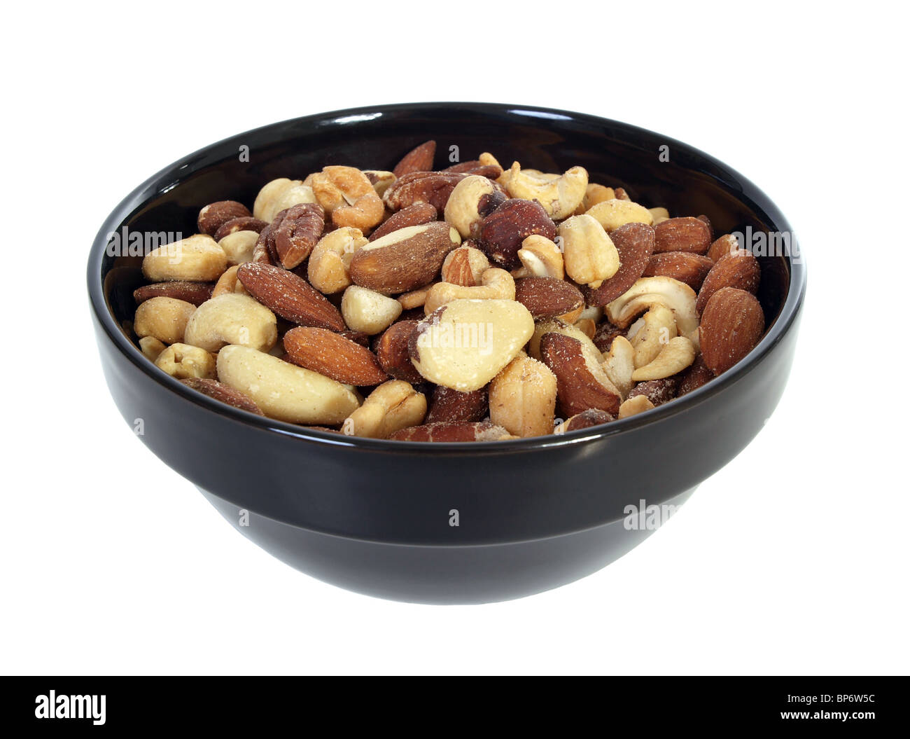 Bowl of deluxe, mixed, salted nuts. Isolated on white. - Stock Image