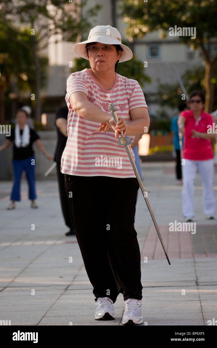Elderly people exercising in the early morning in Hong Kong. - Stock Image