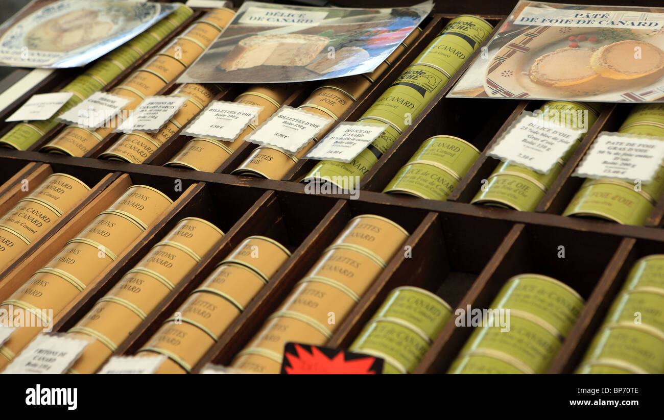 Duck pate on sale in a French market stall in Brantome in the Dordogne area - Stock Image