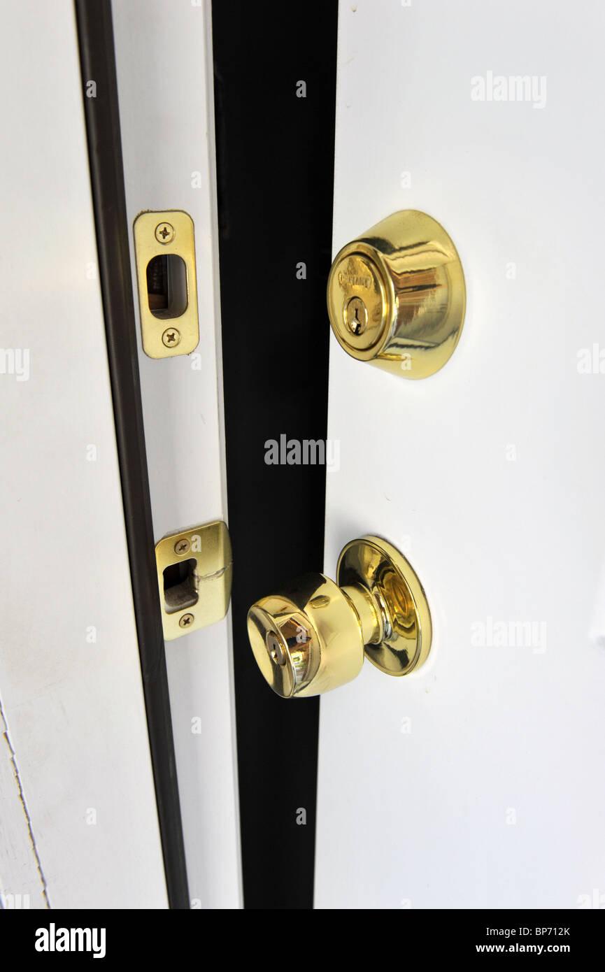 A door slightly opened - Stock Image