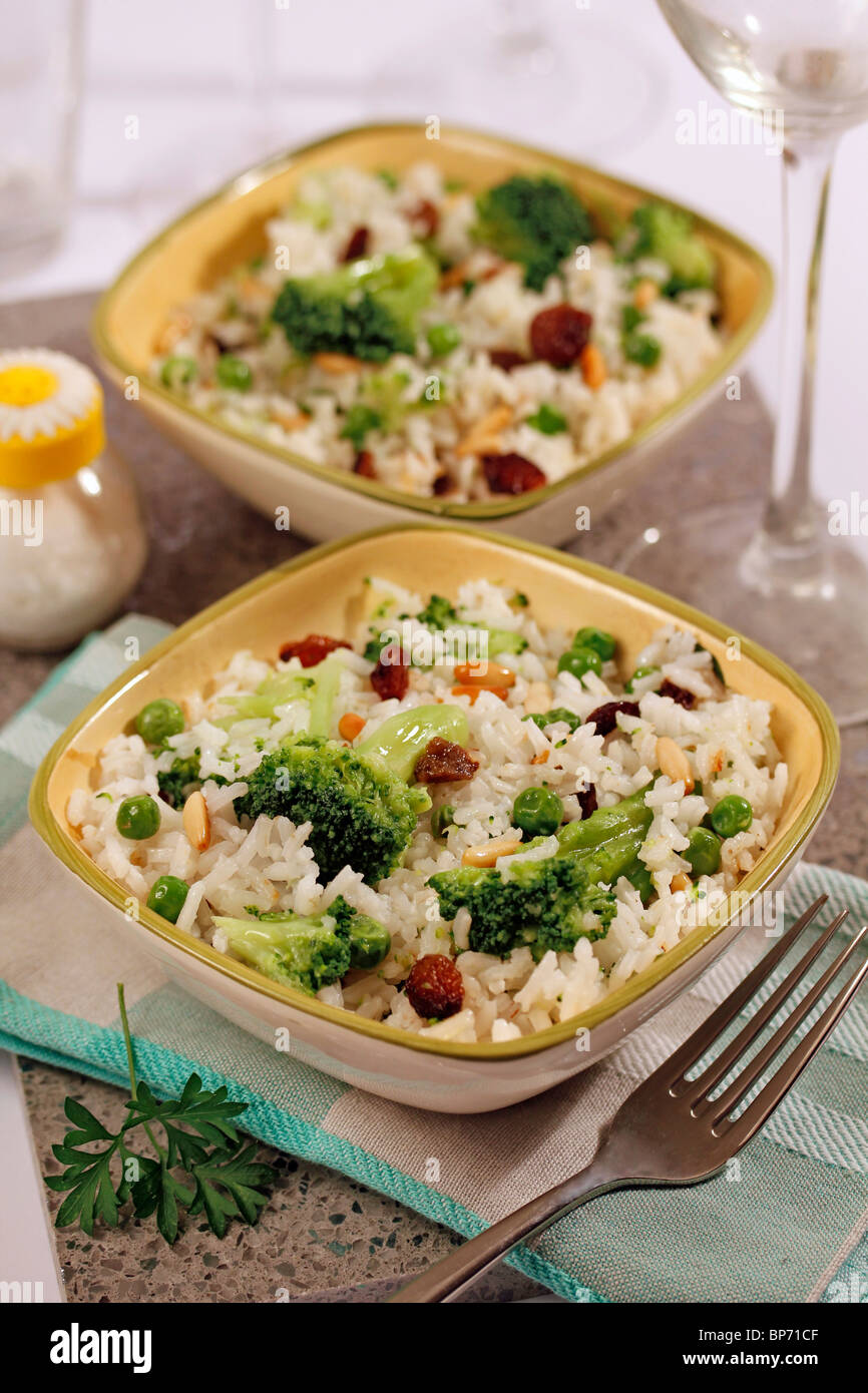 Rice with broccoli and pine nuts. Step by step: PP2J34-PP2J58-PP2J6C-PP2J8F - Stock Image