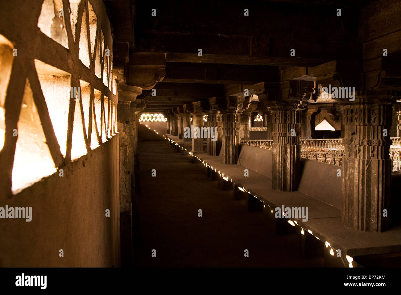 A shaded area within the prayer hall of the Jama Masjid (Friday Mosque) in Ahmedabad, Gujarat, India. - Stock Image