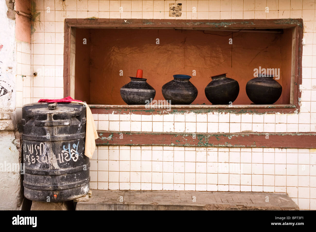 Pots stand ready to be filled with water by a streetside in Ahmedabad, Gujarat, India. - Stock Image