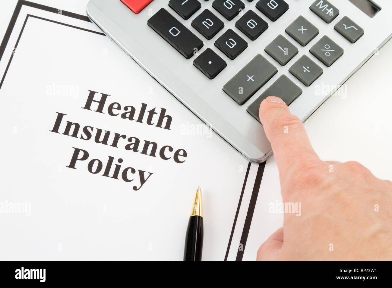 Document of Health Insurance Policy and calculator, for background - Stock Image