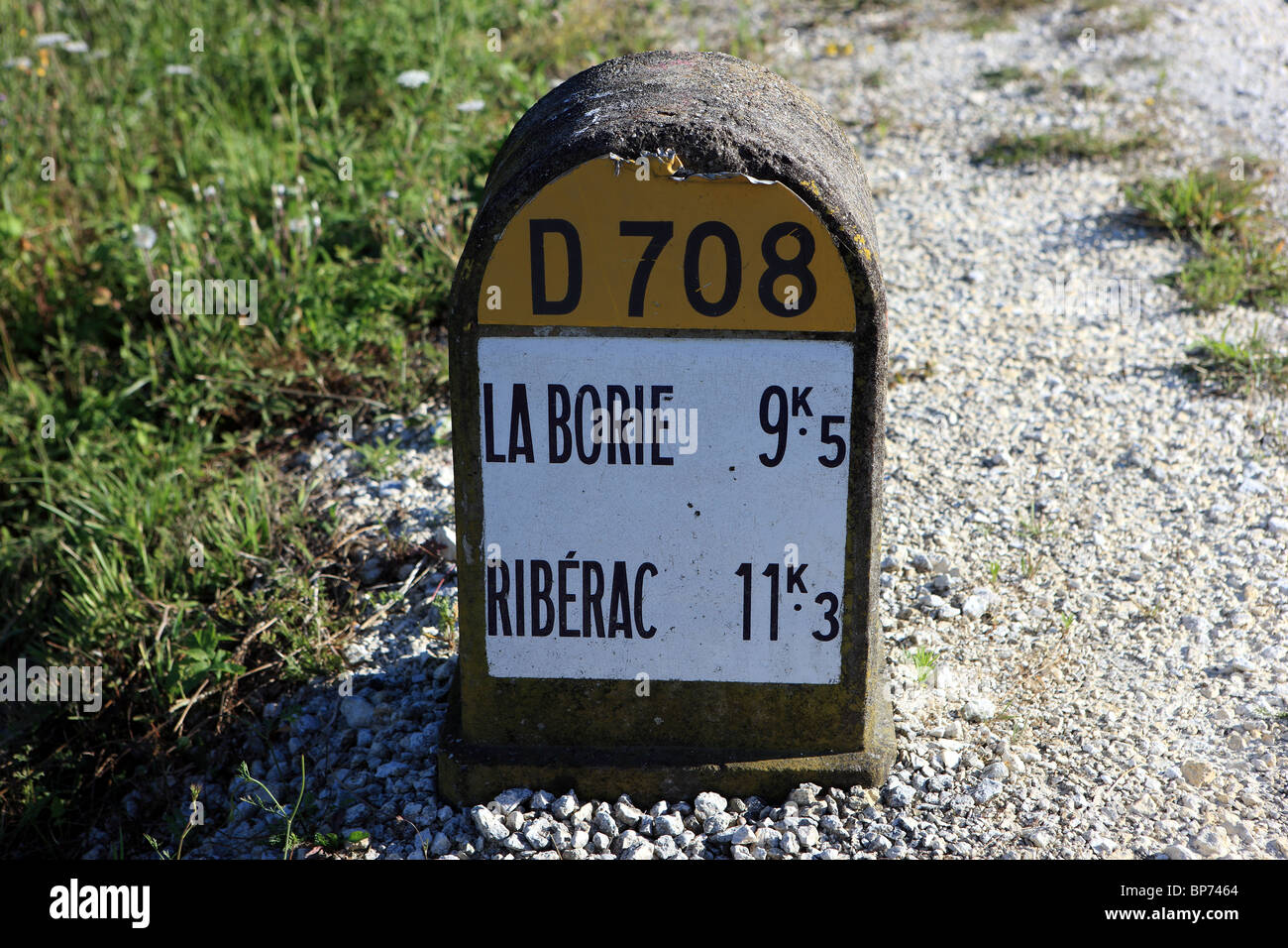French road marker showing the distance to the French towns of La Borie and Riberac - Stock Image