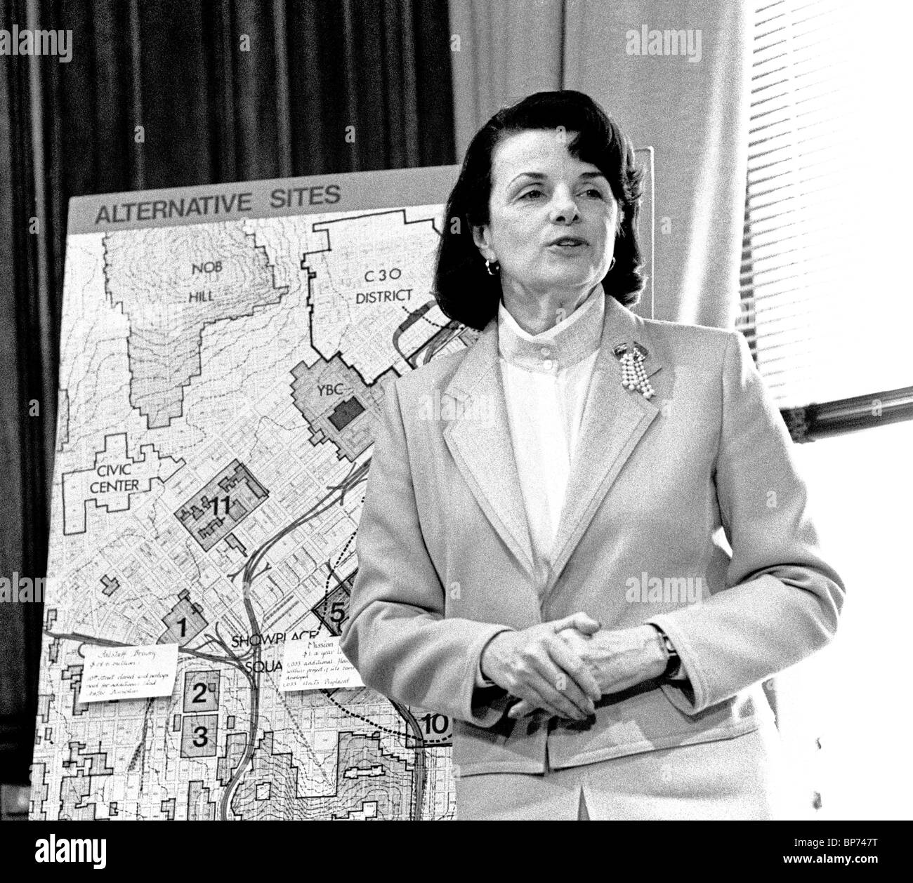 Mayor Dianne Feinstein talks about a new stadium in her office in City Hall, San Francisco California. - Stock Image