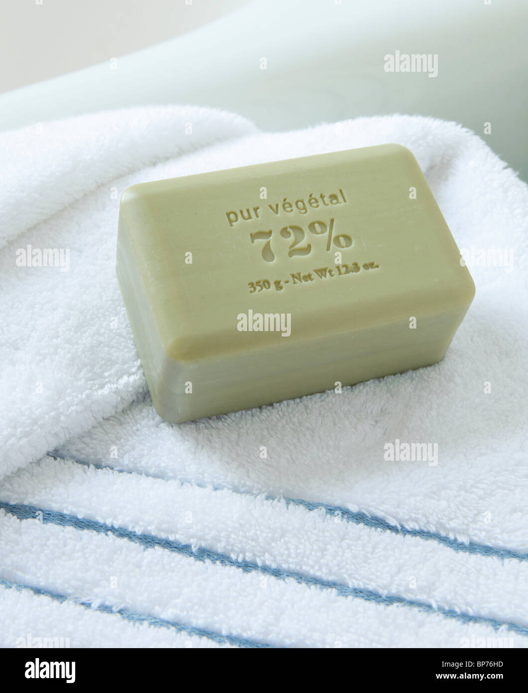 A BAR OF FRENCH SOAP ON A TOWEL - Stock Image