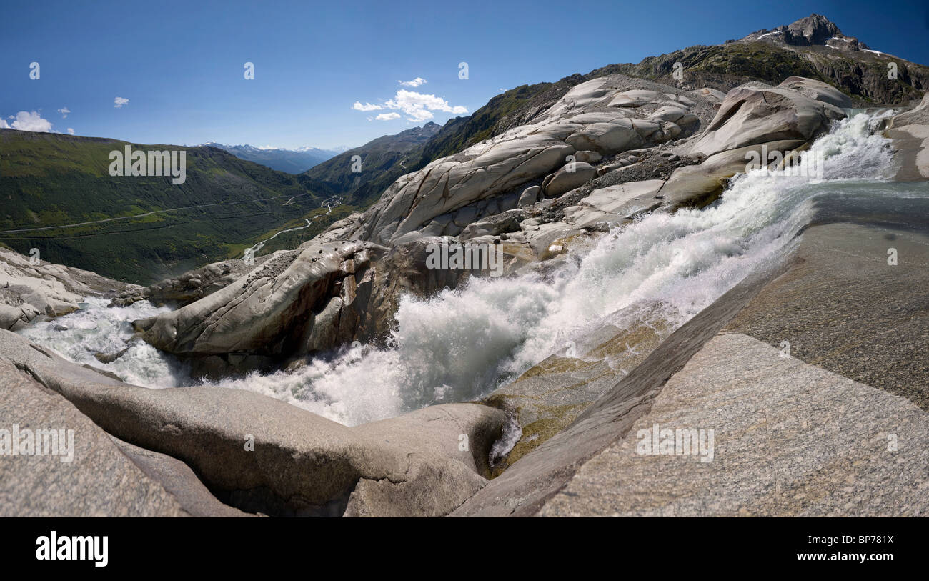 Panoramic summerly view of the waterfall under the Rhone-Glacier in Switzerland - Stock Image