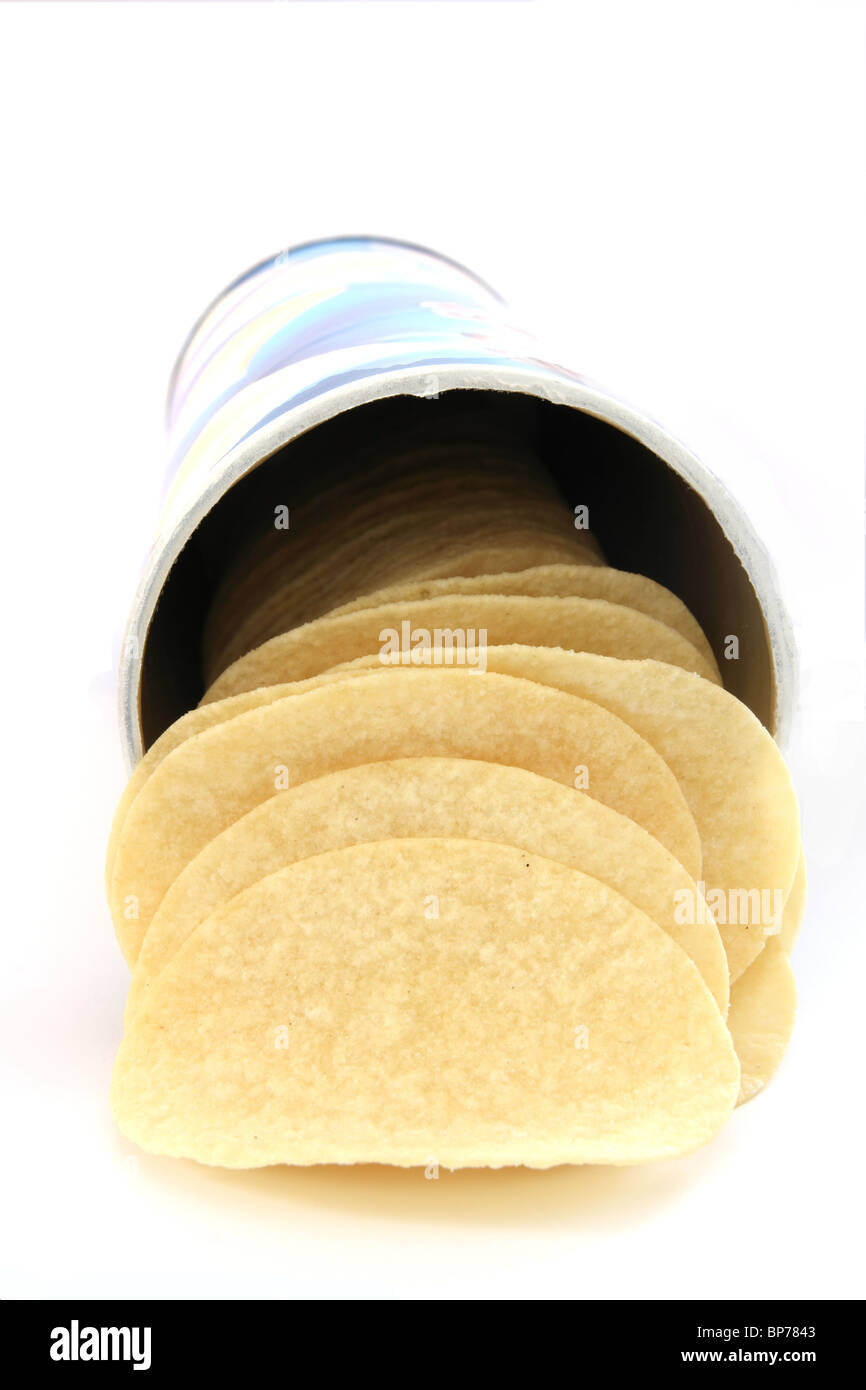 Potato chips on white background in a can - Stock Image