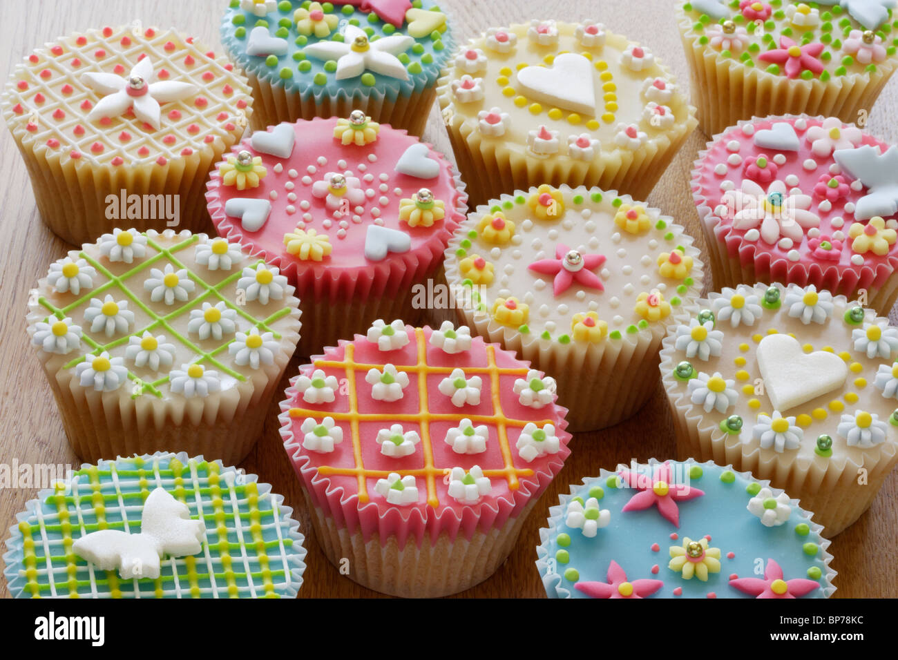 Highly decorated cupcakes or fairy cakes stock photo for Fairy cakes