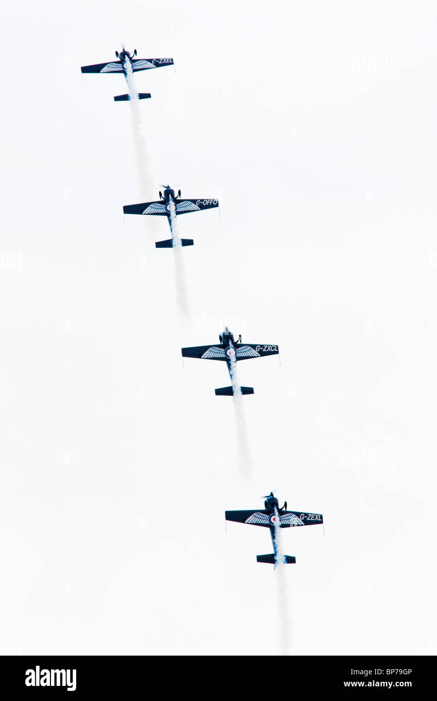 The Blades aerobatic display team flying their Extra 300 LPS's at the Airbourne airshow, Eastbourne, East Sussex, - Stock Image