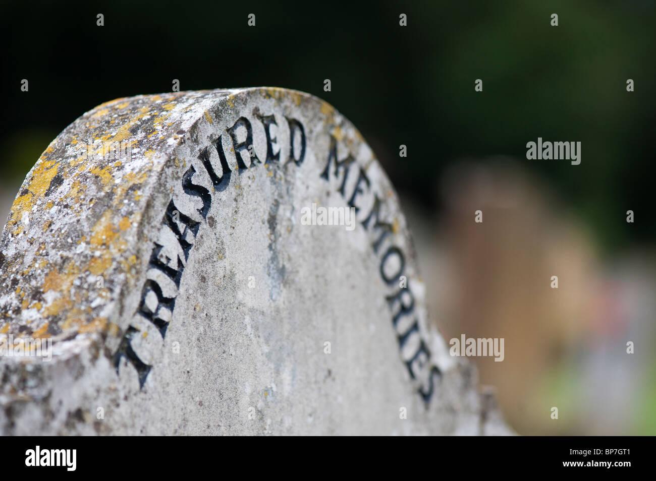 Treasured memories gravestone in churchyard - Stock Image
