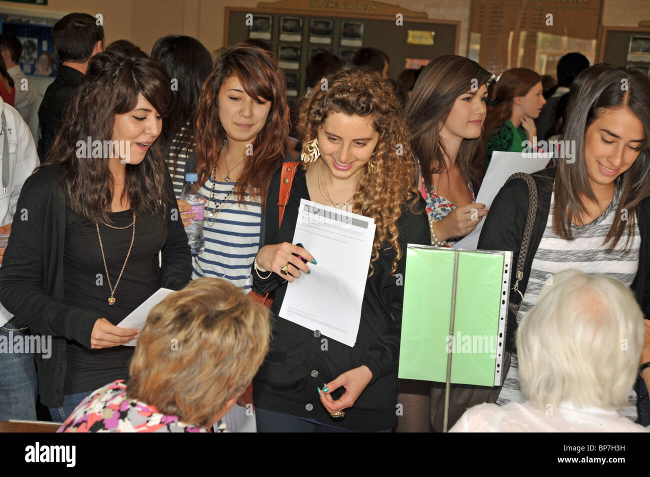 Female sixth form students getting their A Level results at school, UK - Stock Image