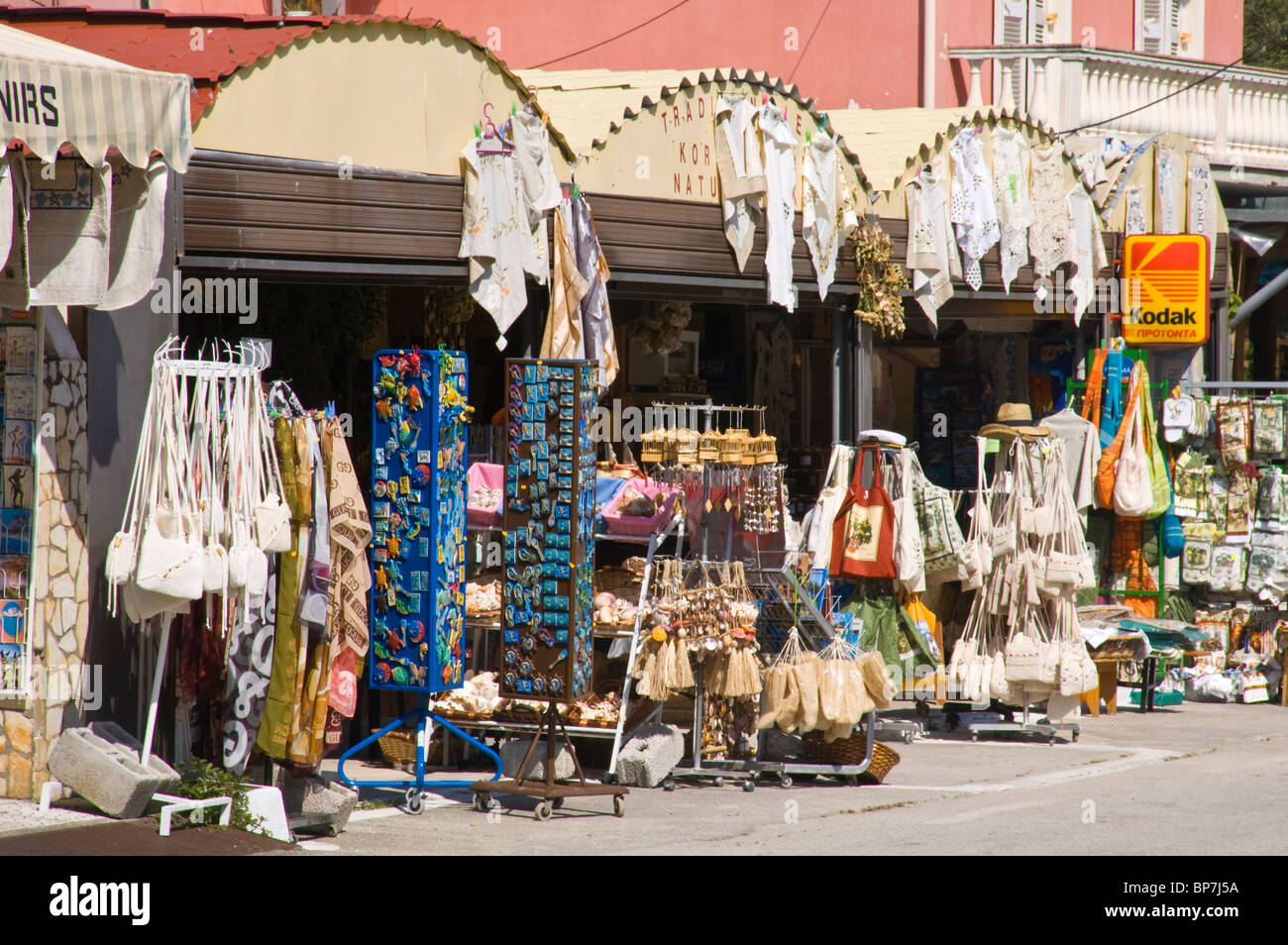 Tourist shops selling souvenirs in the mountain village of Makrades on the Greek Mediterranean island of Corfu Greece - Stock Image