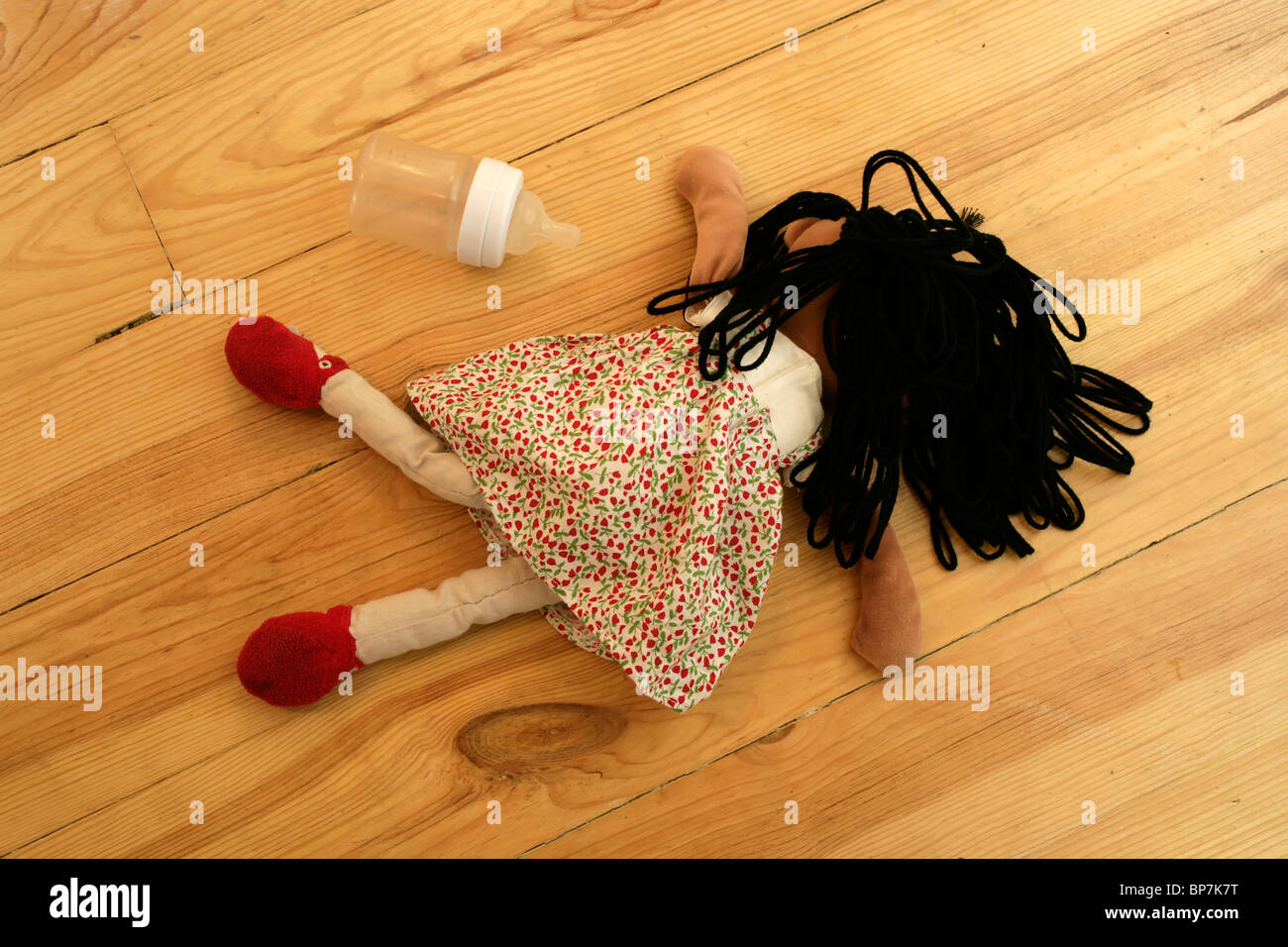 Child's ragdoll and bottle Stock Photo