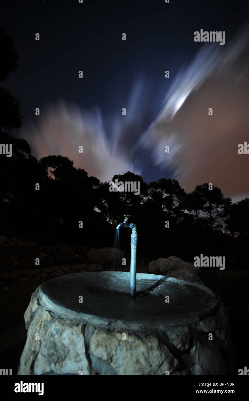 Running tap wasting water - Stock Image