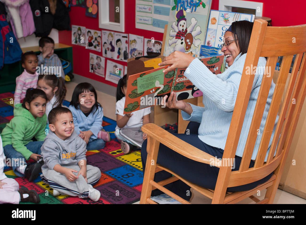 preschool classroom preschool teacher reading a book to her class