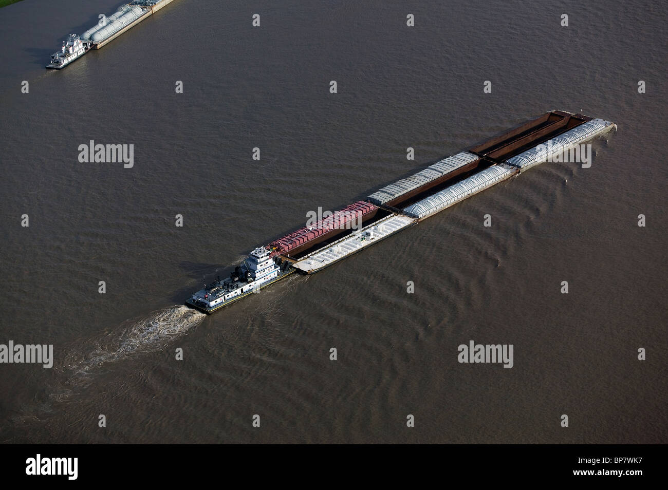 aerial view above barge traffic on Mississippi river Baton Rouge Louisiana - Stock Image