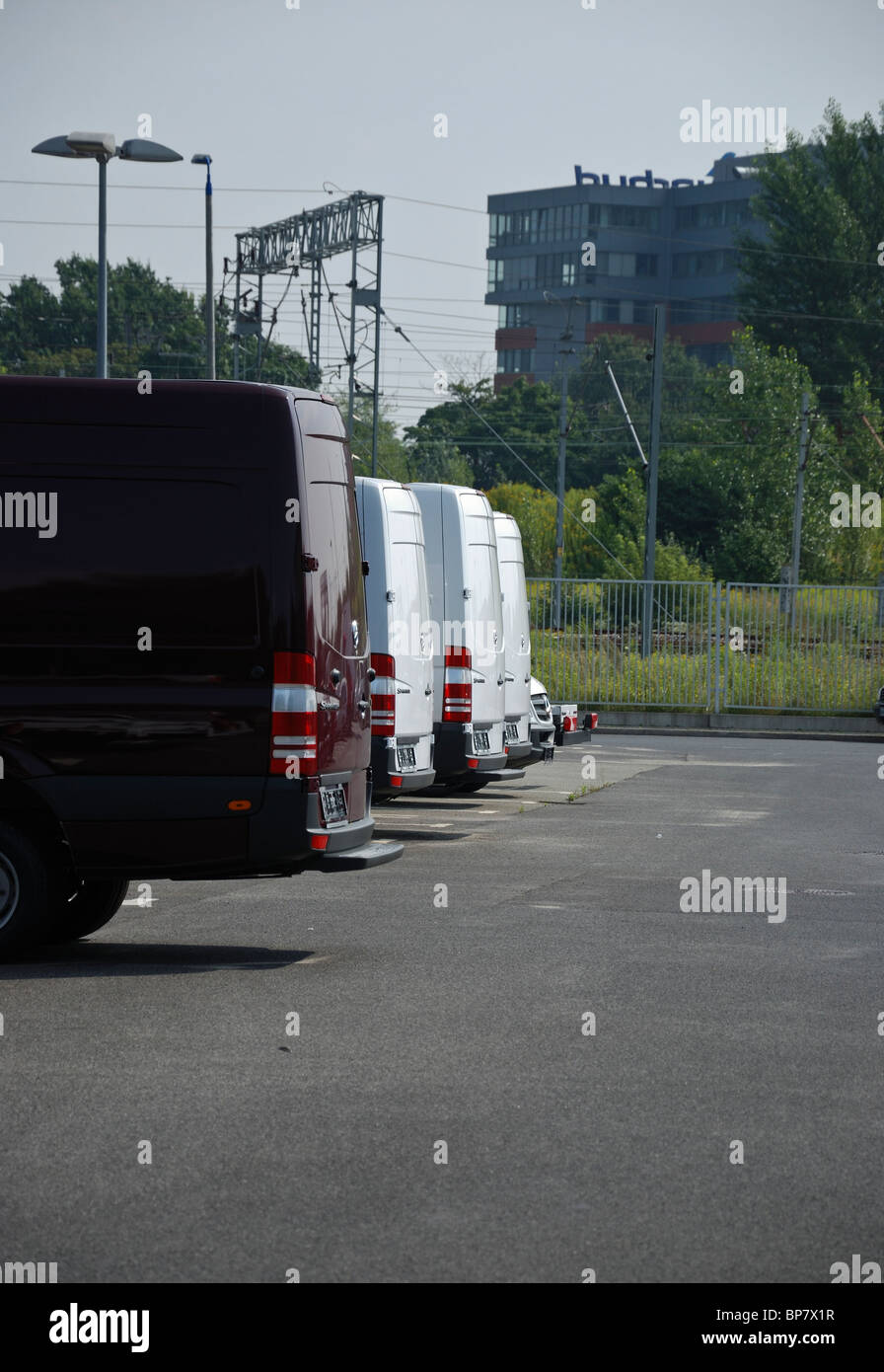Mercedes-Benz Medium Commercial Vehicles (MCV) for sale in a row - Gottlieb Daimler Street 1 MB's car dealership Stock Photo