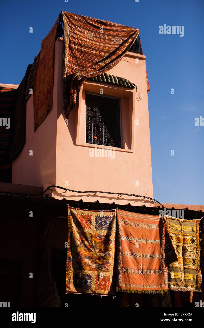 Carpets draped over a building in Marrakech. - Stock Image