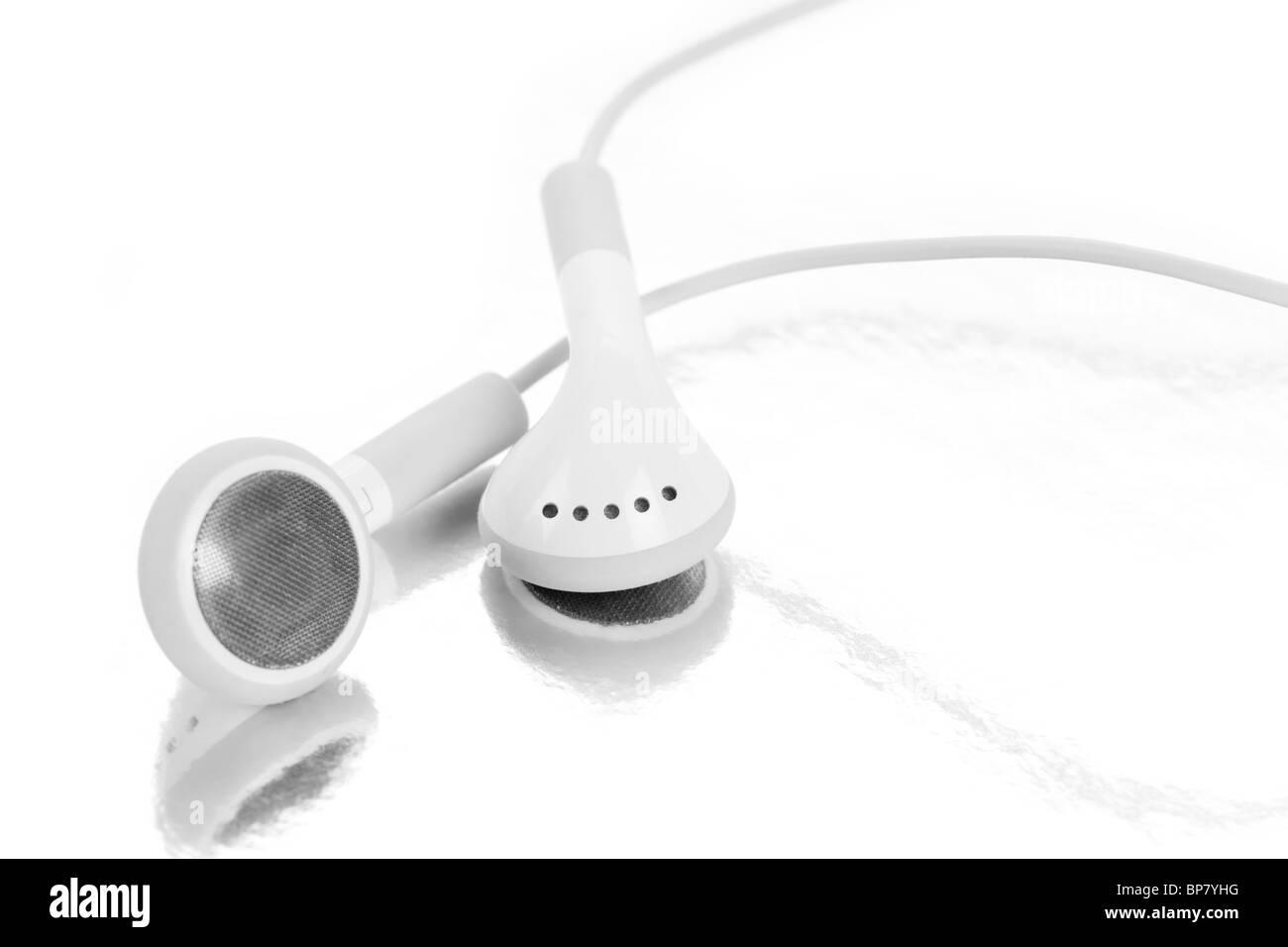 white Headphones, concept of digital music - Stock Image