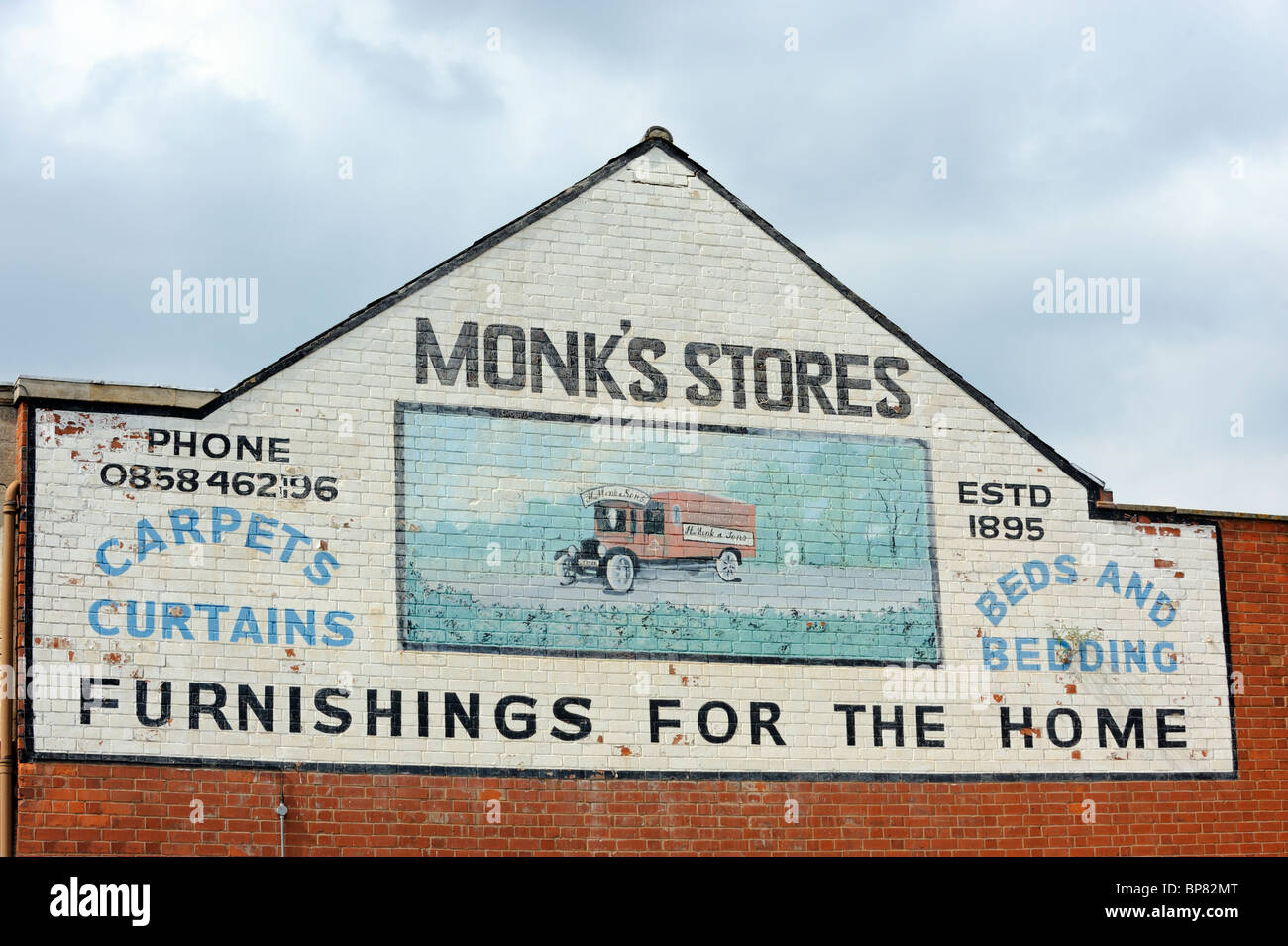 An old painted advertisement, left over from a bygone era in Market Harborough - Stock Image