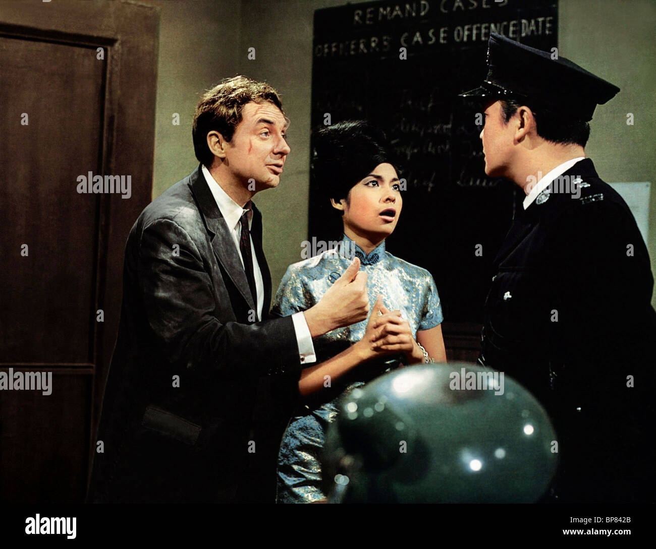 SCENE WITH HARALD JUHNKE RED DRAGON; MISSION HONG KONG (1965) - Stock Image
