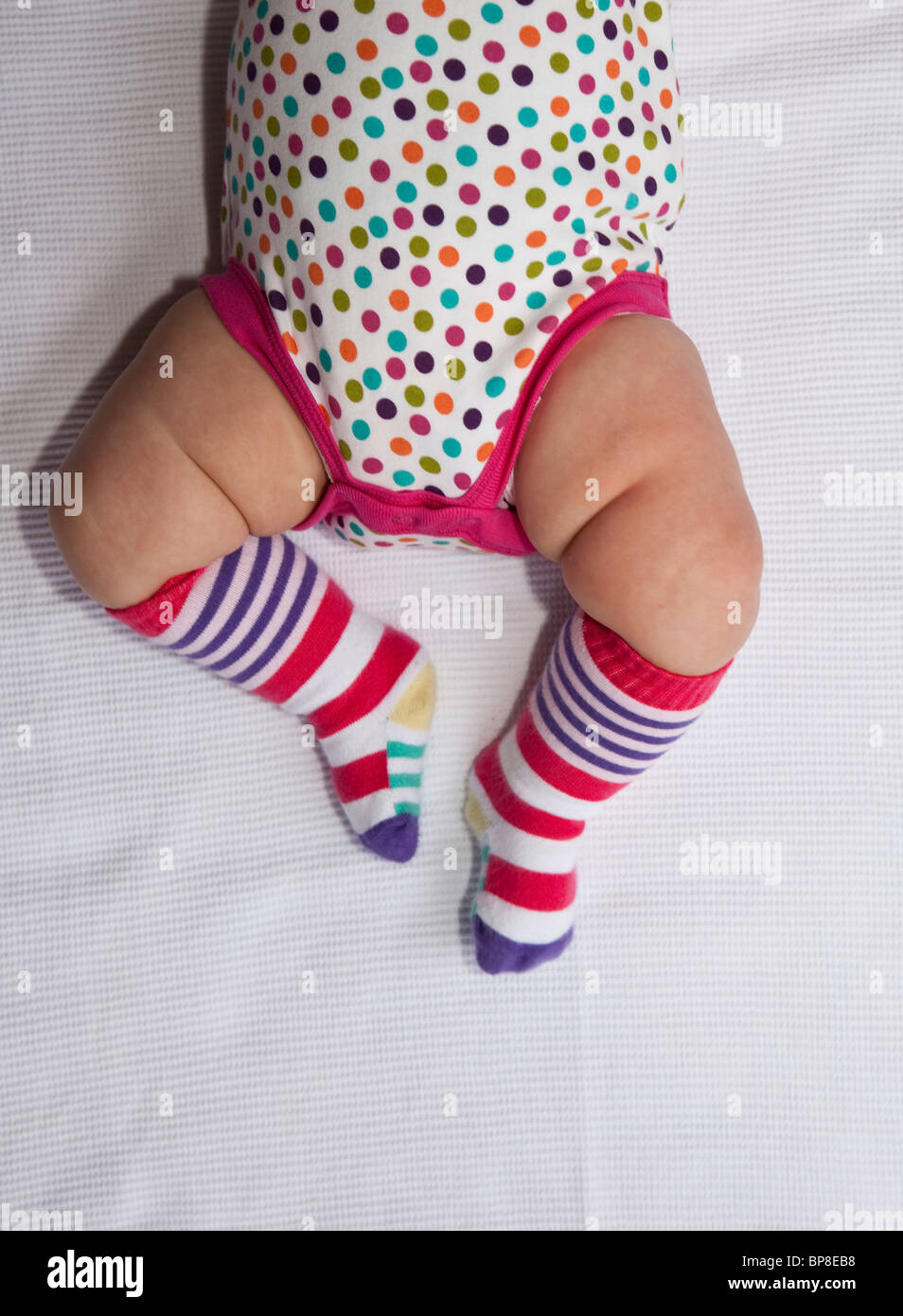 Baby girl with chubby thighs - Stock Image