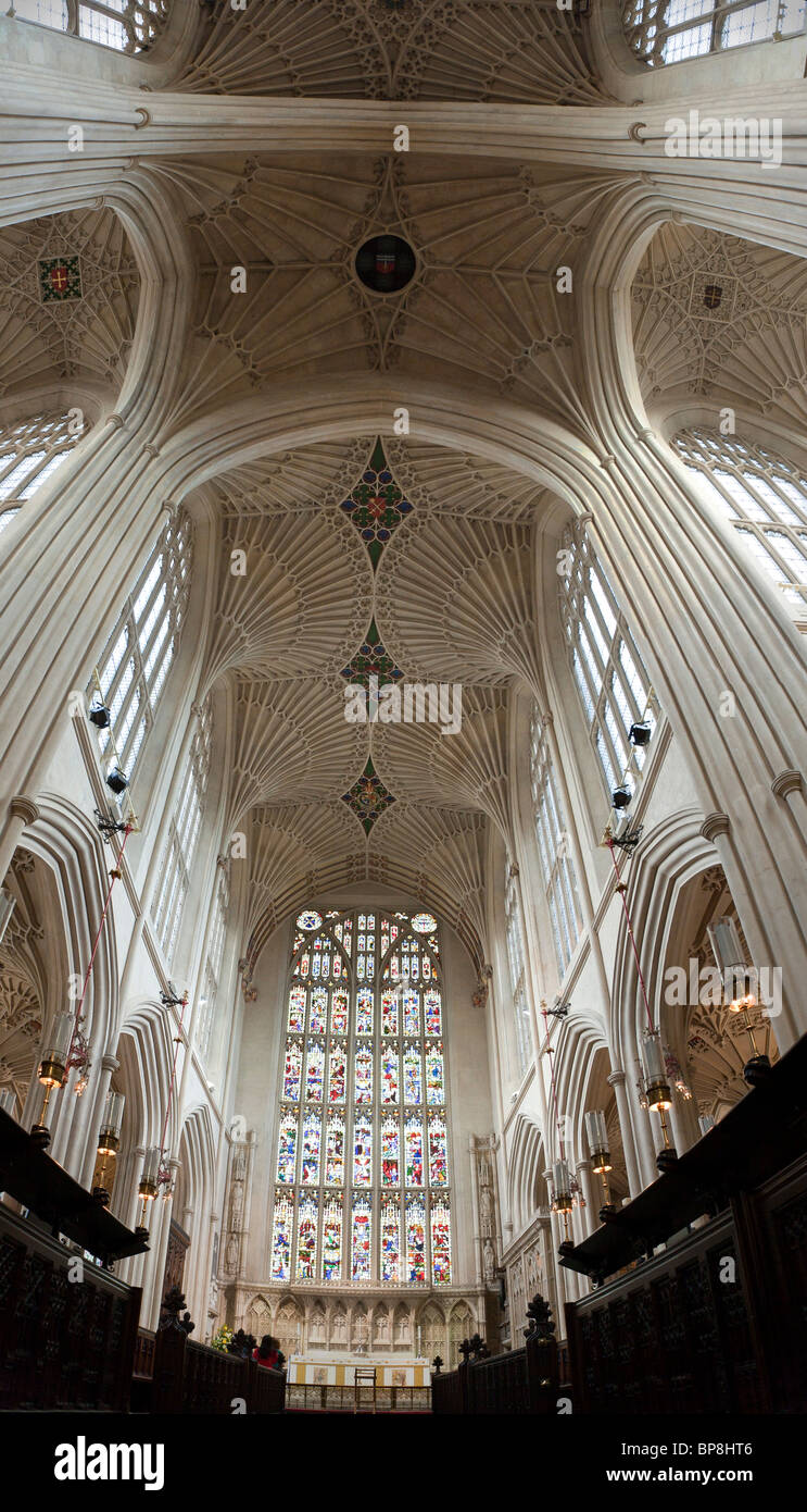 Soaring Ceiling and Stained Glass window above the choir & altar. The fine fan vaulting characterizes the ceiling. - Stock Image