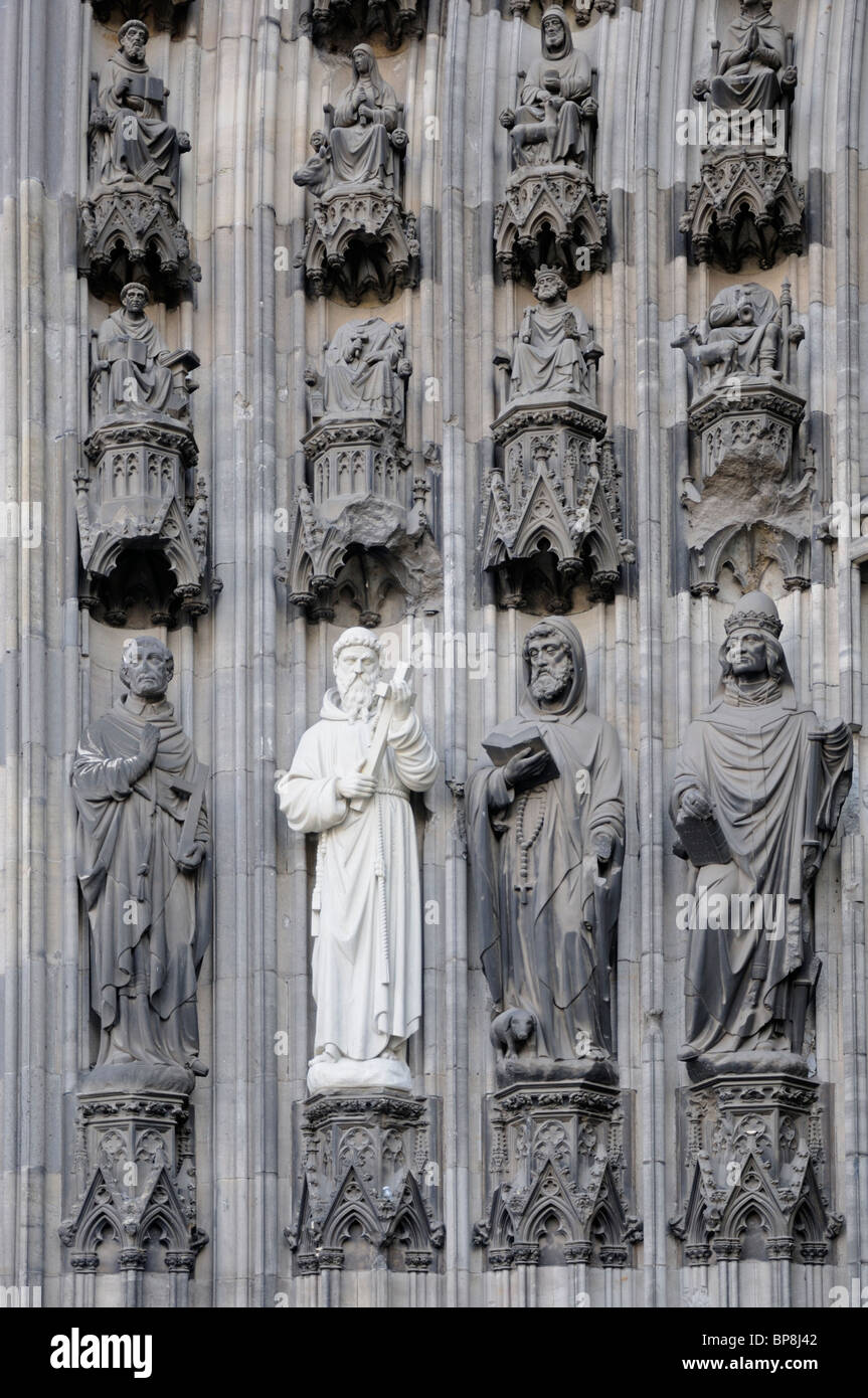 Cologne / Koln, Nordrhein-Westfalen, Germany. Cologne Cathedral / Kolner Dom. (1880) Renewed Statues on facade - Stock Image