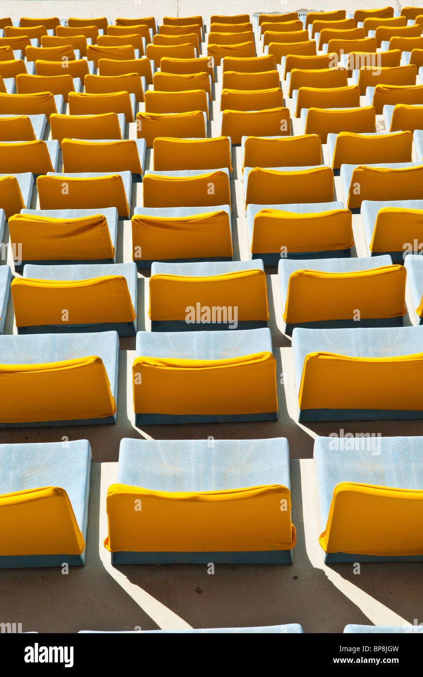 Yellow seats in sports city stadium Beirut Lebanon - Stock Image